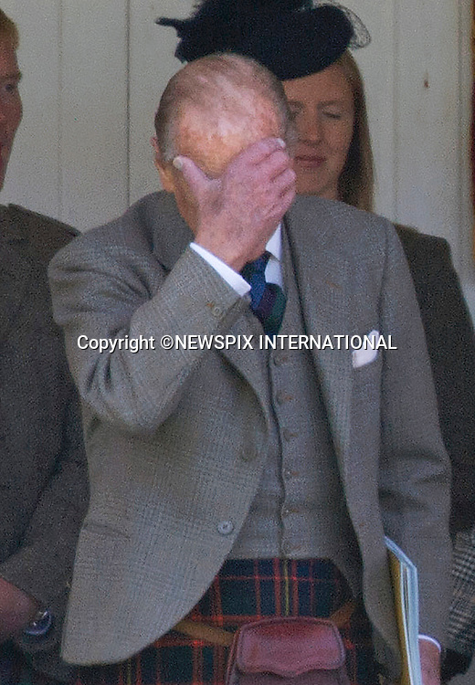05.09.2015; Braemar, Scotland: NOT ANOTHER BOUQUET IS WHAT THE DUKE APPEARS TO REACT<br /> The Royals who included The Queen, Duke of Edinburgh, Prince Charles, Peter Philips and wife Autumn were attending the 200th Braemar Highland Gathering.<br /> Mandatory Photo Credit: &copy;NEWSPIX INTERNATIONAL<br /> <br /> **ALL FEES PAYABLE TO: &quot;NEWSPIX INTERNATIONAL&quot;**<br /> <br /> PHOTO CREDIT MANDATORY!!: NEWSPIX INTERNATIONAL(Failure to credit will incur a surcharge of 100% of reproduction fees)<br /> <br /> IMMEDIATE CONFIRMATION OF USAGE REQUIRED:<br /> Newspix International, 31 Chinnery Hill, Bishop's Stortford, ENGLAND CM23 3PS<br /> Tel:+441279 324672  ; Fax: +441279656877<br /> Mobile:  0777568 1153<br /> e-mail: info@newspixinternational.co.uk