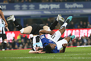 Everton defender Yerry Mina (13) and Newcastle United defender Emil Krafth (17) end up the wrong way up after the challenge during the Premier League match between Everton and Newcastle United at Goodison Park, Liverpool, England on 21 January 2020.
