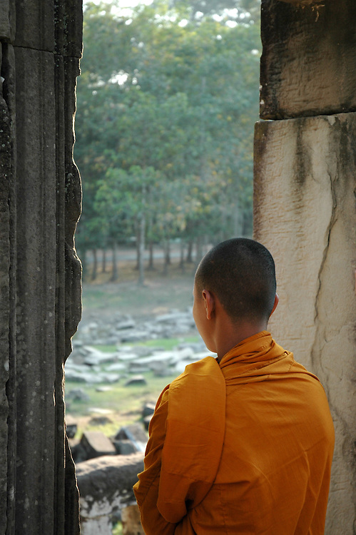 This Cambodian Buddhist monk was meditating at the Bayon temple in the Angkor Thom city.<br />