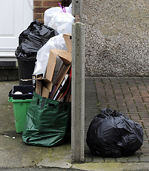 © Licensed to London News Pictures. 15/01/2012. FILE PICTURE. Fines which punish people who put their rubbish out on the wrong day, use incorrect sacks, and overfill their bins are to be scrapped. Current legislation allows local authorities to issue fixed penalty fines of up to £110. Photo credit : Grant Falvey/LNP