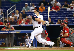 March 12, 2017 - Miami, FL, USA - United States catcher Buster Posey grounds out as teammate third baseman Nolan Arenado scores during the first inning of a World Baseball Classic first round Pool C game against Canada on Sunday, March 12, 2017 at Marlins Park in Miami, Fla. (Credit Image: © David Santiago/TNS via ZUMA Wire)