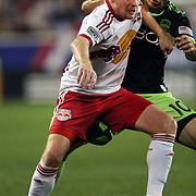Dax McCarty, New York Red Bulls, shrugs off a challenge from Marco Pappa, Seattle Sounders  during the New York Red Bulls Vs Seattle Sounders, Major League Soccer regular season match at Red Bull Arena, Harrison, New Jersey. USA. 20th September 2014. Photo Tim Clayton