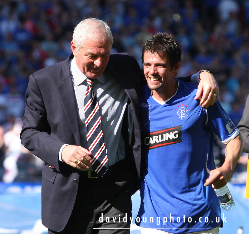 Rangers' manager Walter Smith hugs Nacho Novo after the Homecoming Scottish FA Cup Final - Nacho Novo's goal had won the Final against Falkirk at Hampden Park (picture by David Young - 07765 252616)
