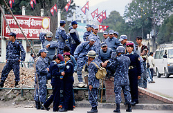 """Kathmandu, 18 February, 2005. Nation's Democracy Day. Police officers gathering after duty at Ratna Park. """"Today we have arrested several people. They were planning pro-democracy rallies, but we didn't give them any chance to demonstrate"""", a police officer said. Authorities have, once again, cut off local telephone lines; public transport has also been banned for most of the day."""