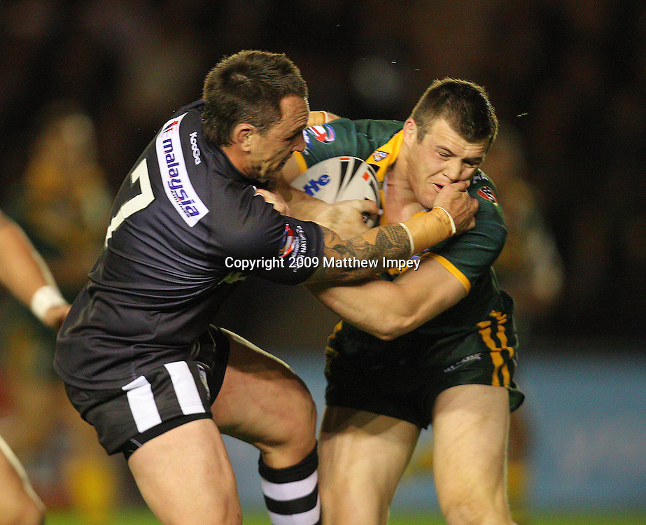 Brett Morris of Australia is tackled by Nathan Fien of New Zealand. Australia v New Zealand, Four Nations, Rugby League, The Stoop, Twickenham, 24/10/2009 © Matthew Impey/Wiredphotos. co. uk. tel: 07789 130 347 email: matt@wiredphotos. co. uk