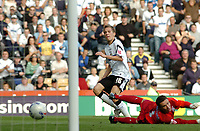 Photo: Kevin Poolman.<br />Derby County v Southend United. Coca Cola Championship. 30/09/2006. Derby's Arturo Lupoli slides the ball past Southend keeper Darryl Flahavan for his second goal.