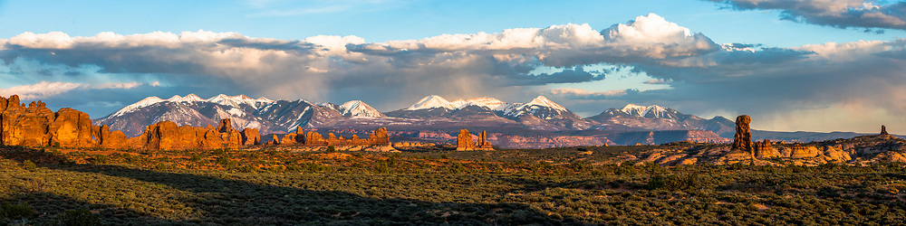 The sun sets across Arches National Park with the La Sal mountains rising in the background. Limited Edition - 75