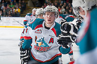 KELOWNA, CANADA - JANUARY 24: Rourke Chartier #14 and Nick Merkley #10 of Kelowna Rockets celebrate a goal against the Everett Silvertips on January 24, 2015 at Prospera Place in Kelowna, British Columbia, Canada.  (Photo by Marissa Baecker/Shoot the Breeze)  *** Local Caption *** Rourke Chartier; Nick Merkley;