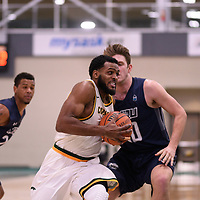 5th year forward Brian Ofori (11) of the Regina Cougars during the Men's Basketball home game on January 5 at Centre for Kinesiology, Health and Sport. Credit: Arthur Ward/Arthur Images