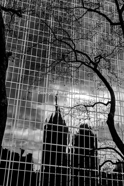 New york - the empire state building reflected on a mirror tower on 42nd street..  - United states   / reflets des buildings sur la 42 me rue.  Empire state building  New York - Etats-unis