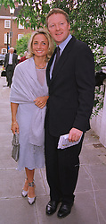 Comedian RORY BREMNER and his fiancee MISS TESSA CAMPBELL-FRASER, at a party in London on 30th June 1999.MTY 64
