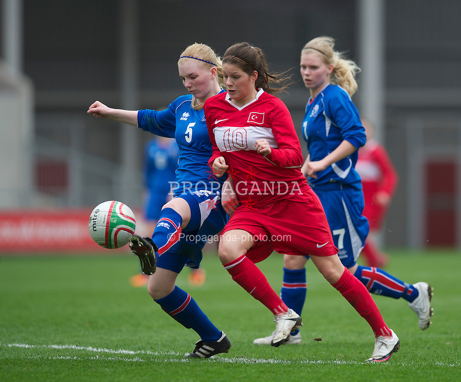 LLANELLI, WALES - Thursday, March 31, 2011: Turkey's Leyla Güngör muscles Iceland's Soley Gudmundsdottir off the ball to score the second of her three goals during the UEFA European Women's Under-19 Championship Second Qualifying Round (Group 3) match at Parc Y Scarlets. (Photo by David Rawcliffe/Propaganda)