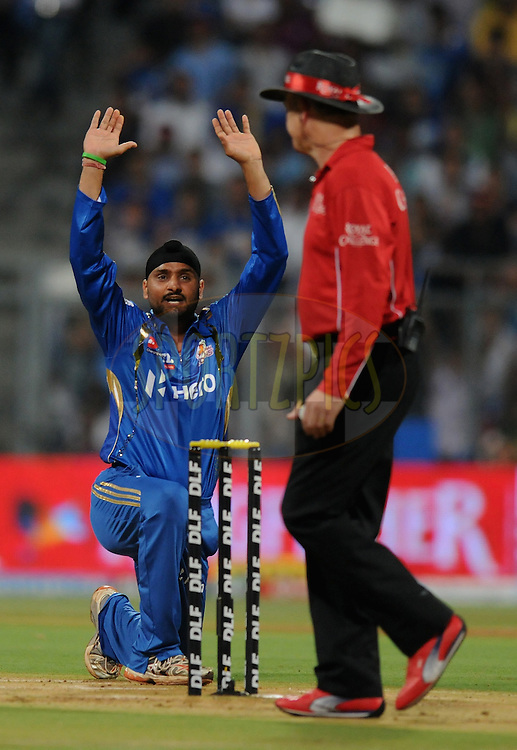 Harbhajan Singh captian of Mumbai Indians appeals unsuccessfully for the wicket of Parthiv Patel of Deccan Chargers during match 40 of  the Indian Premier League ( IPL) 2012  between The Mumbai Indians and the Deccan Chargers held at the Wankhede Stadium in Mumbai on the 29th April 2012..Photo by Pal Pillai/IPL/SPORTZPICS.