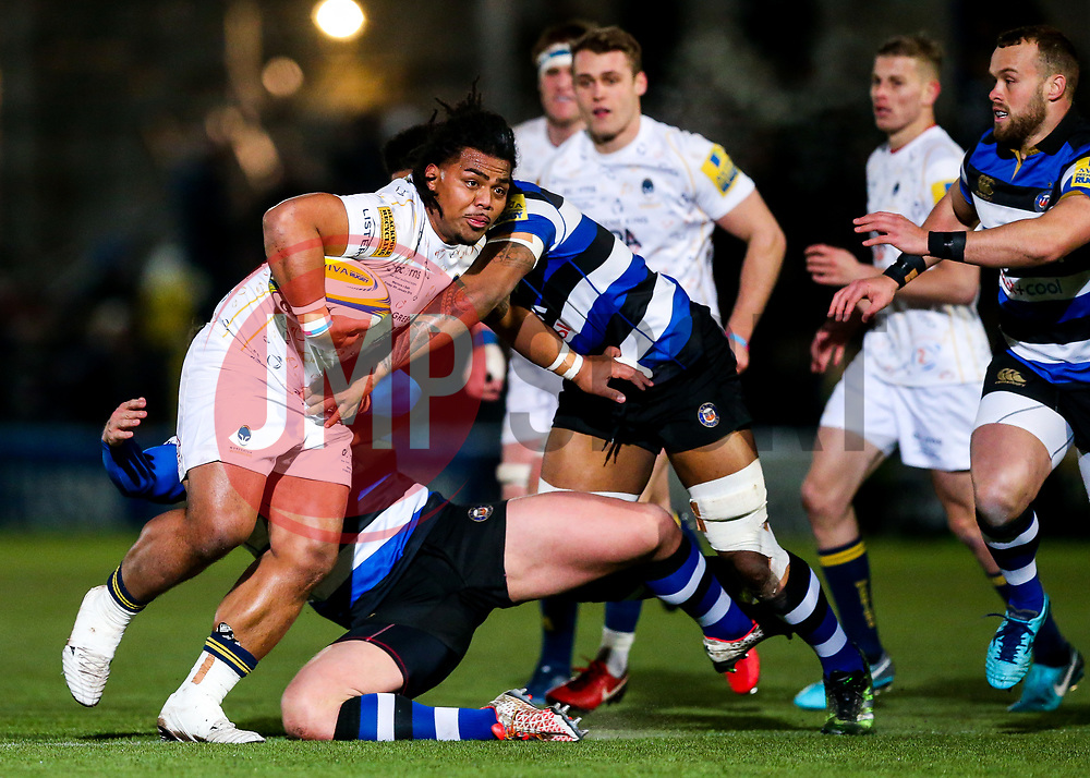 Joe Taufete'e of Worcester Warriors is tackled by Levi Douglas of Bath Rugby - Rogan/JMP - 05/01/2018 - RUGBY UNION - Sixways Stadium - Worcester, England - Worcester Warriors v Bath Rugby - Aviva Premiership.