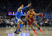 Feb 28, 2019; Los Angeles, CA, USA; Southern California Trojans forward Bennie Boatwright (25)  is defended by UCLA Bruins guard Jules Bernard (3) in the first half at Pauley Pavilion. UCLA defeated USC 93-88 in overtime.