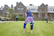 Playing croquet in the garden at Pickwell Manor. From left to right: Zac Baker (11), Liza Baker (9), Molly Elliott (10). Pickwell Manor, Georgeham, North Devon, UK.<br /> CREDIT: Vanessa Berberian for The Wall Street Journal<br /> HOUSESHARE