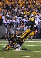 October 2 2010: Iowa Hawkeyes kicker Michael Meyer (96) kicks an extra point from the hold of Iowa Hawkeyes holder Ryan Donahue (5) during the first half of the NCAA football game between the Penn State Nittany Lions and the Iowa Hawkeyes at Kinnick Stadium in Iowa City, Iowa on Saturday October 2, 2010. Iowa defeated Penn State 24-3.