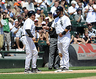 """CHICAGO - JULY 6:  Nick Swisher #30 of the Chicago White Sox exchanges """"knuckles"""" with third base coach Jeff Cox #6 during the game against the Oakland A's at U.S. Cellular Field in Chicago, Illinois on July 6, 2008.  The White Sox defeated the A's 4-3.  (Photo by Ron Vesely)"""