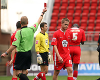 Photo: Chris Ratcliffe.<br />Leyton Orient v Swansea City. Coca Cola League 1. 26/08/2006.<br />Justin Miller of Leyton Orient is sent off by referee Andy Hall for a professional foul and also gives a penalty which Leon Knight missed.