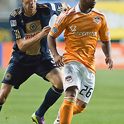 Dynamo Defender Corey Ashe #26 keep possession of ball as Union Attacker Sebastien Le Toux #9 try to defend during Saturday MLS regular season match. The Dynamo and The Philadelphia Union played to a 1-1 tie. Saturday Aug. 6, 2011. at PPL Park in Chester PA...The News Journal/SAQUAN STIMPSON