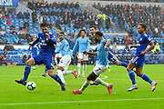 Raheem Sterling (7) of Manchester City crosses the ball past Sean Morrison (4) of Cardiff City during the Premier League match between Cardiff City and Manchester City at the Cardiff City Stadium, Cardiff, Wales on 22 September 2018.