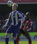.Photo Peter Spurrier.06/04/2002.Nationwide Div 2.Brentford vs Huddersfield - Griffen Park:.Huddersfield defender Nathan Clarke, shields. the ball from Lloyd Owusu...