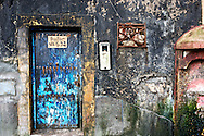 An address on a blue door in the Atlantic coastal city of Essouira, Morocco.