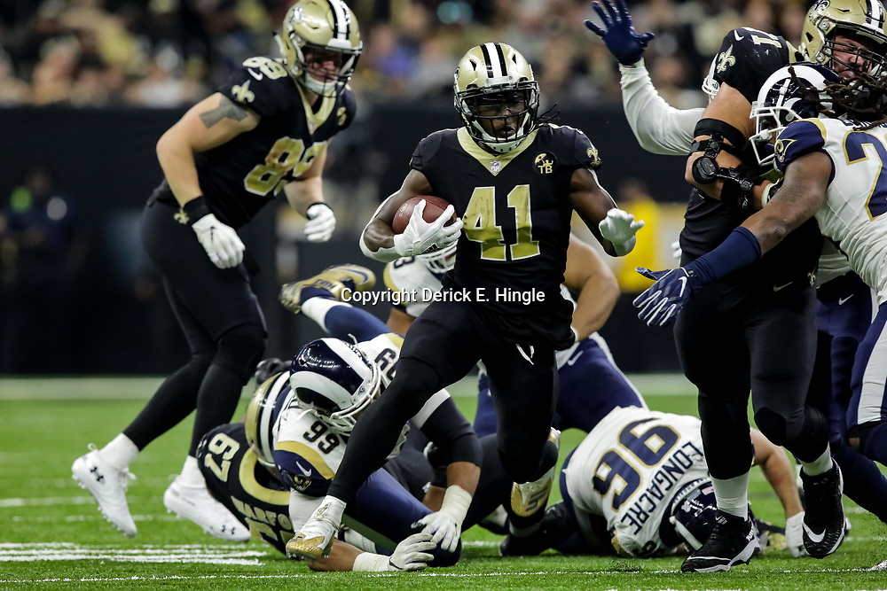 Nov 4, 2018; New Orleans, LA, USA; New Orleans Saints running back Alvin Kamara (41) runs against the Los Angeles Rams during the first half at the Mercedes-Benz Superdome. Mandatory Credit: Derick E. Hingle-USA TODAY Sports