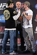 BIRMINGHAM, ENGLAND, NOVEMBER 3, 2011: Renan Barao (left) and Brad Pickett face off at the pre-fight press conference for UFC 138 inside the Hilton Hotel on November 3, 2011.