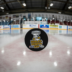 TRENTON, ON  - MAY 6,  2017: Canadian Junior Hockey League, Central Canadian Jr. &quot;A&quot; Championship. The Dudley Hewitt Cup Championship Game between Trenton Golden Hawks and Georgetown Raiders.   Dudley Hewitt puck at centre ice. <br /> (Photo by Alex D'Addese / OJHL Images)