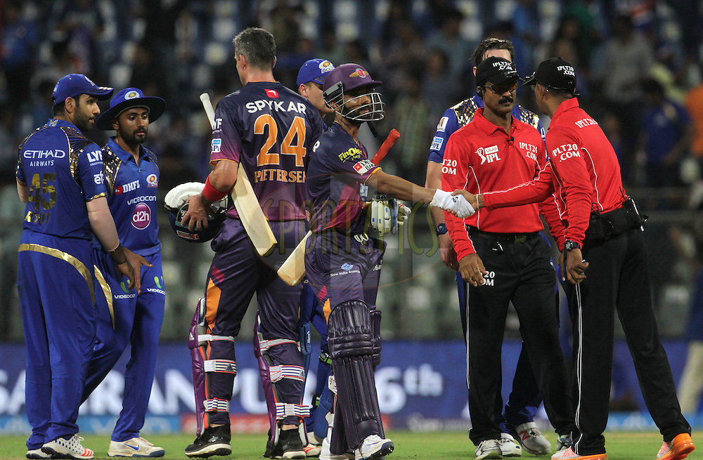 Rising Pune Supergiants player Ajinkya Rahane shake hands with umpires after the match 1 of the Vivo Indian Premier League ( IPL ) 2016 between the Mumbai Indians and the Rising Pune Supergiants held at the Wankhede Stadium in Mumbai on the 9th April 2016<br /> <br /> Photo by Vipin Pawar/ IPL/ SPORTZPICS