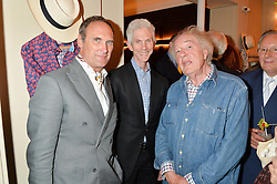 Left to right, AA GILL, RICHARD BUCKLEY and MICHAEL GAMBON at the launch of the new collection from Limoland held at Anderson & Sheppard's Haberdashery, 17 Clifford Street,London on 16th June 2014.