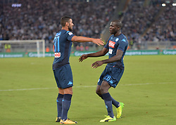 September 20, 2017 - Rome, Italy - Kalidou Koulibaly celebrates with Faouzi Ghoulam after scoring a goal during the Italian Serie A football match S.S. Lazio vs S.S.C. Napoli at the Olympic Stadium in Rome, september on 21, 2017. (Credit Image: © Silvia Lore/NurPhoto via ZUMA Press)