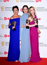 Fiona Shaw, Phoebe Waller-Bridge and Jodie Comer in the press room after winning the award for Best Drama Series at the Virgin Media BAFTA TV awards, held at the Royal Festival Hall in London.