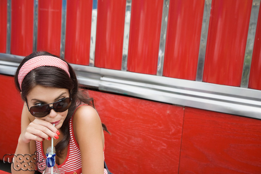 Young Woman Drinking a Soda