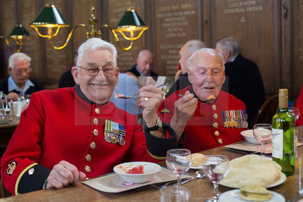 © licensed to London News Pictures. London, UK 02/10/2012. Chelsea Pensioners eating puddings as they launch The Soldiers' Charity Big Curry season with a special curry lunch at Royal Hospital Chelsea's Royal Hall in London on 02/10/12. Photo credit: Tolga Akmen/LNP