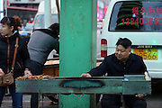 SHENYANG, CHINA - MARCH 19: (CHINA OUT) <br /> <br /> A BBQ Vendor Looks Like Kim Jong-un<br /> <br /> A BBQ vendor aged 36 looks like Kim Jong-un walks in a street on March 19, 2014 in Shenyang, Liaoning Province of China. The man is famous for his face looks like Kim Jong-un that make his BBQ stall hot. ©Exclusivepix