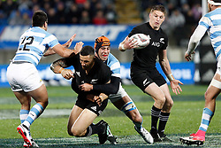 New Zealand's Beauden Barrett, right, catches the ball as team mate Sonny Bill Williams is tackled by Argentina's Guido Petti, centre, in the Investic Rugby Championship Test match at Yarrow Stadium, New Plymouth, New Zealand, Saturday, September 09, 2017. Credit:SNPA / Dean Pemberton  **NO ARCHIVING**