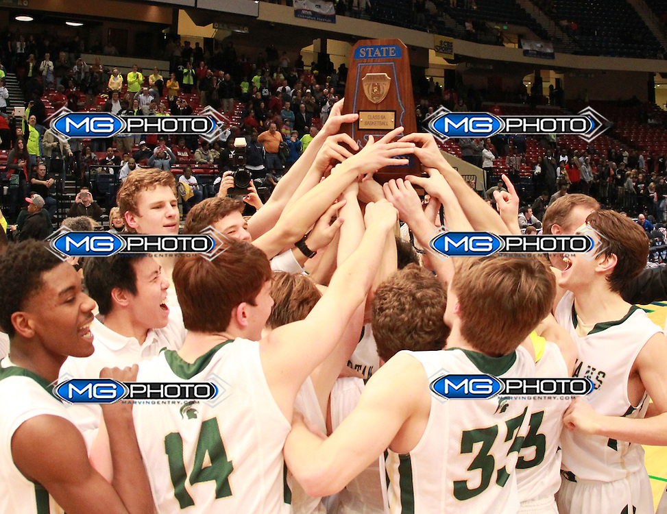 March 2, 2013; Birmingham, AL, USA;  The team members of Mountain Brook High school hoist the State Championship Trophy for Basketball at the Alabama High School State Basketball Championships at the Birmingham Jefferson Civic Center. Mandatory Credit: Marvin Gentry