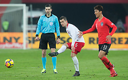 March 27, 2018 - Chorzow, Poland - Krzysztof Maczynski of Poland vies Woo-young Jung (KOR),   during the international friendly soccer match between Poland and South Korea national football teams, at the Silesian Stadium in Chorzow, Poland on 27 March 2018. (Credit Image: © Foto Olimpik/NurPhoto via ZUMA Press)