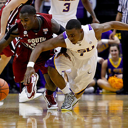 Jan 16, 2013; Baton Rouge, LA, USA; South Carolina Gamecocks guard Bruce Ellington (23) steals the ball from LSU Tigers guard Anthony Hickey (1) during the first half of a game at the Pete Maravich Assembly Center. Mandatory Credit: Derick E. Hingle-USA TODAY Sports