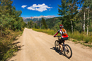Cyclist on the Galloping Goose Trail, Uncompahgre National Forest, Colorado USA (MR)