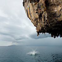 "Thai climber ""deep water soloing"" without rope, splashes to earth, Poda Island, Krabi, Thailand"