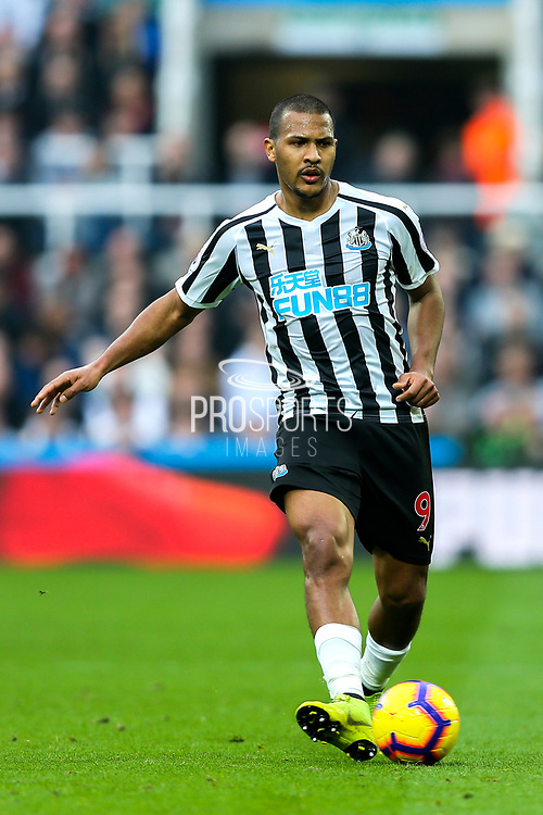 Jose Salomon Rondon (#9) of Newcastle United plays a short pass along the ground during the Premier League match between Newcastle United and Huddersfield Town at St. James's Park, Newcastle, England on 23 February 2019.