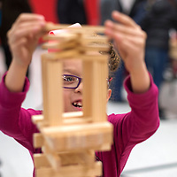 D'Amari Money builds a tower using Kapla blocks during the family ¡Explora! night held at Red Rock Elementary in Gallup Tuesday. Children could freely rotate between ten activity stations which demonstrated different scientific ideas.