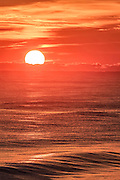 Sun rising over the Atlantic ocean on  the Outer Banks of NC.
