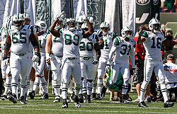 Sept 20, 2009; East Rutherford, NJ, USA;  New York Jets wide receiver Jerricho Cotchery (89) leads the Jets onto the field during the first half at Giants Stadium.
