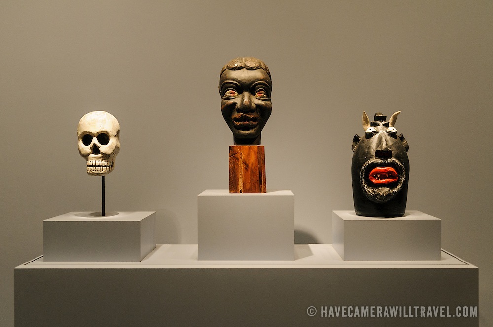 Three stylized heads that form part of the folk art exhibit at the Donald W. Reynolds Center for American Art and Portraiture in downtown Washington DC.