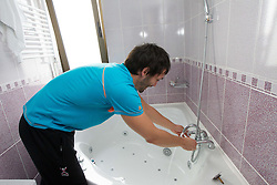 David Spiler making a bath during visit in the rooms of Slovenia Men Handball team during 5th day of 10th EHF European Handball Championship Serbia 2012, on January 19, 2012 in Hotel Srbija, Vrsac, Serbia.  (Photo By Vid Ponikvar / Sportida.com)