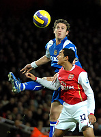 Photo: Ed Godden.<br /> Arsenal v Portsmouth. The Barclays Premiership. 16/12/2006. Arsenal's Theo Walcott (R), is challenged by Sean Davis.